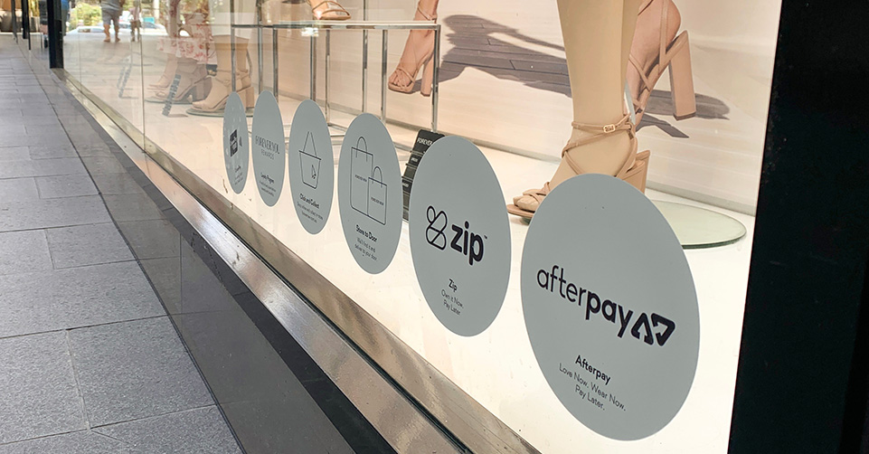 Buy now pay later brands on business shop front