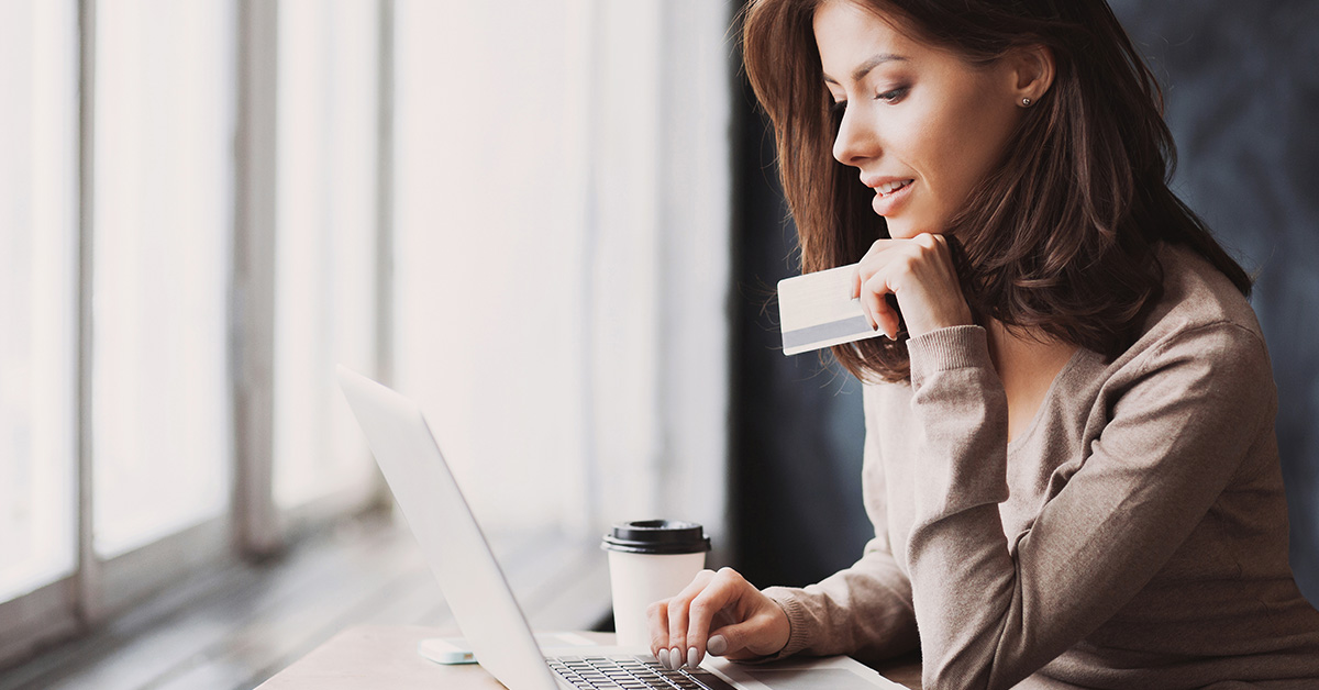 Woman at computer with credit card